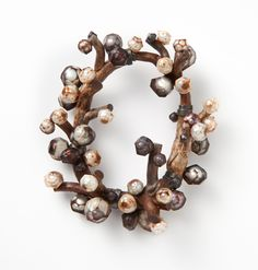 Terhi Tolvanen Perles 2012.  Brooch height 10 cm. Faceted pearls, heather wood, silver. Private collections.
