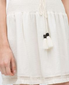 Image 6 of MINI SKIRT WITH POMPOM DETAIL from Zara