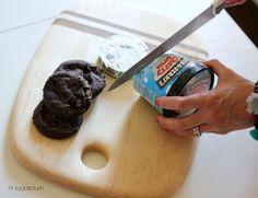 Using a serrated knife, cut through the ice cream carton to make ice cream cookies.