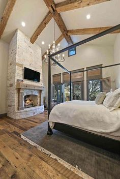 This remarkable farmhouse style home was designed by Oscar E Flores Design Studio and built by Todd Glowka Builder, located on a sprawling ranch in Texas Hill Country. home A fresh farmhouse designed with reclaimed timbers in Texas Hill Country Farmhouse Style Bedrooms, Farmhouse Master Bedroom, Farmhouse Design, Master Bedrooms, Modern Farmhouse Exterior, Farmhouse Interior, Farmhouse Ideas, Dream Bedroom, Home Bedroom