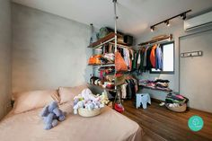 By luxe design singapore. Like the industrial style shelving next to bed, which acts as a room divider