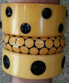 Ivory and black vintage bakelite bracelets.
