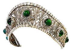 Grand Duchess Elizabeth Feodorovna's Diamond and Cabochon Emerald Tiara / Kokoshnik /   The tiara's frame is made of gold and silver, set with diamonds and seven domed emerald cabochons.   This tiara was made by the Russian court jeweller Bolin in 1884 as a wedding gift for  Grand Duchess Elizabeth Feodorovna of Russia  from Grand Duke Sergei Alexandrovich, who inherited the emeralds from his mother, the wife of Tsar Alexander II. It later belonged to the Russian Grand Duc...