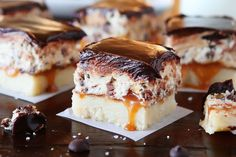 Cookie Dough Billionaire Bars. The most amazing dessert you can bring to a potluck ever. 4 Layers of Shortbread, Salted Caramel Sauce, Cookie Dough, and homemade Chocolate Ganache.