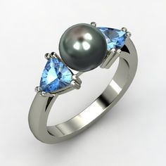 This would be a perfect mom's ring! Milo and Jude both gave blue topaz for their birthstone! Love this ring!!!!