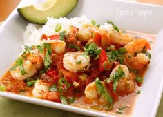 Garlic Shrimp in Coconut Milk, Tomatoes and Cilantro Recipe Main Dishes with jumbo shrimp, extra-virgin olive oil, red bell pepper, scallions, cilantro, garlic, kosher salt, crushed red pepper flakes, diced tomatoes, light coconut milk, lime