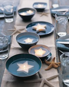 Cookie-Cutter Candles Use a set of graduated cookie cutters to make stars or other shapes in varying sizes. Arrange the candles on a platter, or place them in shallow dishes of water for a unique centerpiece. Get the Cookie-Cutter Candles How-To Beach Wedding Tables, Beach Wedding Centerpieces, Unique Centerpieces, Candle Centerpieces, Wedding Table Settings, Seaside Wedding, Centrepieces, Centerpiece Ideas, Beach Weddings