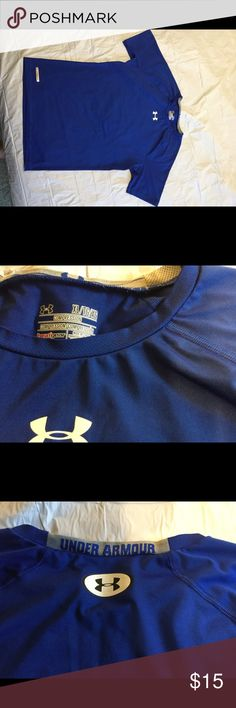 XL blue Under Armour shirt. XL blue Under Armour shirt. Very good condition. I love the Under Armour on the back of the collar. This shirt does not say youth XL but it fits like a youth XL. Under Armour Shirts & Tops Tees - Short Sleeve