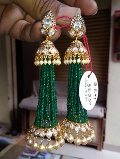 28 gms emerald beads earrings in kundans and south sea pearl hangings.<br>triangle three leaf eartop studded with kundan diamonds and jhumki having multi thread emearld beads and south sea pearls hangings. Gold Earrings Designs, Gold Jewellery Design, Fancy Jewellery, Necklace Designs, Jhumki Earrings, Beaded Earrings, Wedding Earrings, Diamond Earrings, Real Gold Jewelry