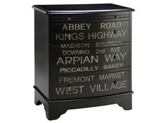 Three-drawer accent chest with a hand-painted text motif. Product: Accent chestConstruction Material: WoodColor: Black and beigeFeatures: One pull-out shelfThree drawersHand-painted text motif Dimensions: 33 H x 28 W x D