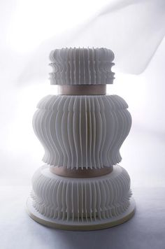 This wedding takes on the style of a baroque paper lantern in classic tones of white and bronze.