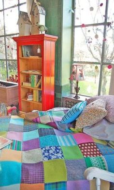 colorful patchwork quilt in a whimsical bedroom