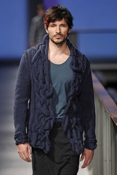 "Andrés Velencoso complementing a Josep Abril  chunky deep blue cardigan. Abril has used through his knitwear collection a combination of deep muted colour palette that complemented each other. FW14/15 ""Reflections' Collection at 080 Barcelona Fashion Week."