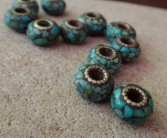 Tibetan Turquoise Mosaic Donut Bead, Silver Plated Brass Detailing, $8.25 by AquaTerraBazaar Material: Turquoise, Silver-plated Brass  Size: 10.5 mm - 12 mm w, depth is 6 mm - 7 mm, hole opening width is 3.5 mm - 4 mm Qty: One