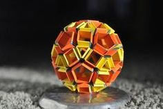Snapology is a type of unit origami created by Heinz Strobl which requires the folding of strips of paper to produce amazing origami pieces. Unit Origami can be. Geodesic Sphere, Paper Folder, Paper Pop, Arts And Crafts, Paper Crafts, Diy Cardboard, Origami Paper, Fractals, Diy Projects