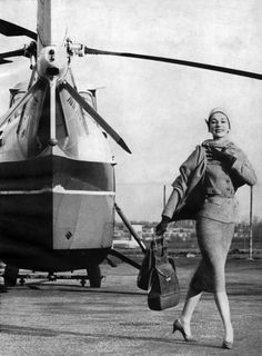 Anastasia Jejune,( herself a three time Gold medalist ), arrives at Canberra heliport on her way to judge the 'Womens Vapid-pondering Relay' events at the 53 0lympics.