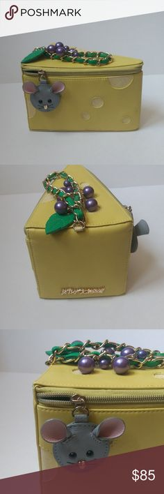 "Betsey Johnson Kitsch Big Cheese Yellow Wristlet Please see photos for wear. NOTE this bag is marked a sample, was a first run of the design, still authentic, purchased from betsey johnson.   Faux yellow leather with glitter cheese holes. Zipper closure with faux leather mouse head charm. Faux green leather and gold chain strap with big green leaf and ""grape"" beads. Betsey Johnson Bags Clutches & Wristlets"