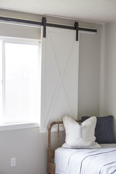 This barn door window treatment plays off the current barn door trend in home de. Door Window Covering, Door Window Treatments, Window Treatments Living Room, Living Room Windows, Window Coverings, Making Barn Doors, Diy Barn Door, Diy Door, Barn Door Hardware