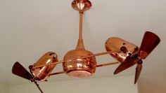 Room Design: Exclusive And Unique Ceiling Fans Without Lamp Colored With Gold Shine Feature Divide With 2 Small Fans Each Side And Also Has Solid Handlegrip from Decorating Room With  distinct Ceiling Fans