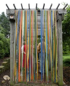 Long, streaming, waterproof ribbons add a burst of color to an otherwise drab pergola.