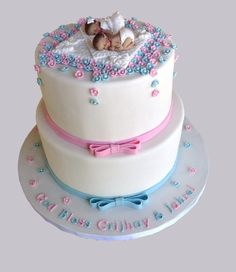 A very elegant 2 Tier Twins Christening cake with dual flavors on each tier. Baby Girl Christening Cake, Baptism Cakes, Fondant Cakes, Cupcake Cakes, Gateau Baby Shower Garcon, Boy Communion Cake, Baby Shower Cakes For Boys, Twin Baby Shower Cake, Baby Reveal Cakes