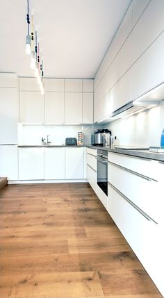 One of our recent projects. A matt white kitchen with a Hi-Macs worktop and Siemens appliances. German Kitchen, Kitchen Inspiration, Kitchen Storage, Kitchens, Kitchen Cabinets, Projects, Design, Home Decor, Log Projects
