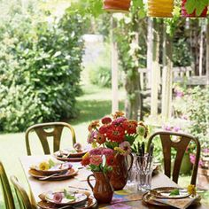 For a pulled-together party look, pair inexpensive paper lanterns with flowers from your garden