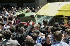 ON EDGE: A crowd attacked a minibus carrying gay-rights activists Friday in Tblisi, Georgia, during a rally to mark the annual International Day Against Homophobia and Transphobia. (Reuters)