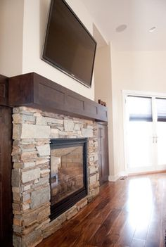 Really like this fireplace. Like the stone work, simple look. Also like the laminate wood flooring.