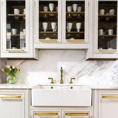 Brass kitchen grey and marble dreams www.herringbonekitchens.com