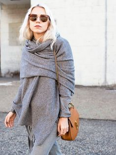 Step 1: Drape your (unfolded) scarf evenly over both shoulders. Step 2: Tuck one of the front corners back behind the opposite shoulder, underneath the scarf. Step 3: Take the remaining front corner, put it over the opposite shoulder and tuck it in behind your neck to keep it in place.