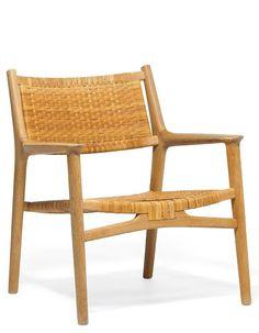 "Hans J. Wegner: ""JH 515"" stoel gemaakt van hout en rotan."