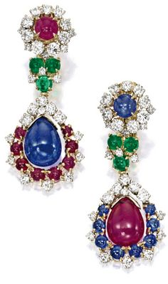 PAIR OF GEM-SET AND DIAMOND PENDENT EARRINGS, BULGARI Of mis-matched design, suspending a drop-shaped ruby and sapphire respectively, to a frame set with brilliant-cut diamonds, cabochon sapphires and rubies, to a surmount set with cabochon sapphire and ruby respectively, connected by cabochon emeralds, the emeralds, rubies, sapphires and diamonds altogether weighing approximately 2.00, 9.00, 8.50 and 3.50 carats respectively, mounted in 18 karat yellow gold, signed Bulgari.