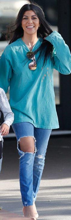 Kourtney Kardashian  Sunglasses – Le Specs Coat – Purse, strap, and key  chain – Fendi Shoes – Alexander McQueen f5407de3c5ed