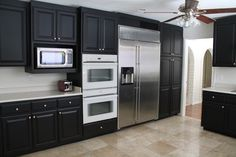 Krypton paint color sw 6247 by sherwin williams view for Black onyx kitchen cabinets