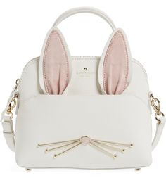 Absolutely adoring this Kate Spade crossbody bag in the shape of a cute rabbit that will instantly add a whimsical touch to any ensemble.