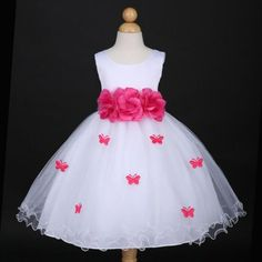 Color: White / Fuchsia hot Pink Size: 6 Months - 10 Years Old    Length: Tea-Length    Features:  Beautiful butterfly petal accents with matching