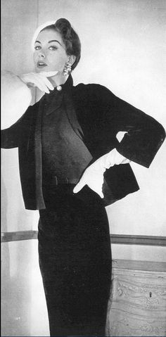 1953 Nancy Berg in wool skirt, sweater and cardigan-style jacket from Carolyn Fashions, Vogue, September