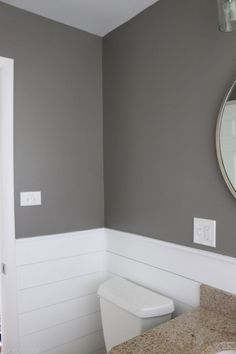 """This bathroom is painted in Behr's """"Creek Bend"""" and I absolutely love this moody gray. Such a great color in this small space."""