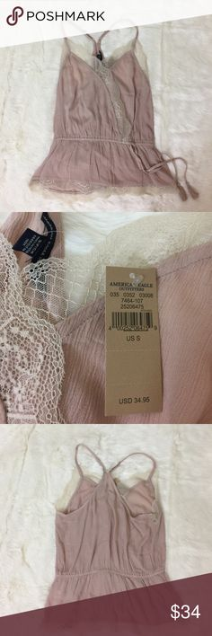 NWT American Eagle Lace Peplum Cami Never been worn. Gorgeous racerback tank top. Lace lining and adjustable tie in the mid of the shirt. Would look super cute under a cardigan for the colder months! NO TRADES NO LOWBALLING •• all reasonable offers are welcome :) American Eagle Outfitters Tops