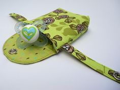 DIY-pacifier pocket. Hang it on your diaper bag to always know where your pacifier is.