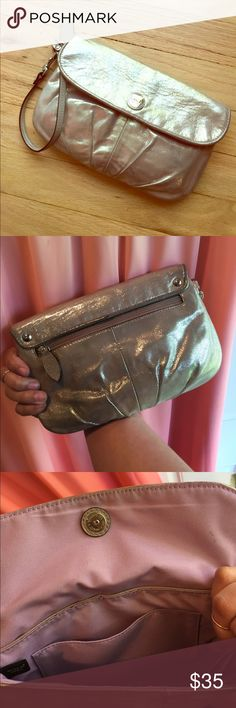 Coach clutch/wristlet Lovely shimmery gold exterior with a light lavender interior. Great for a weekend night out or holding those essentials for weddings Coach Bags Clutches & Wristlets