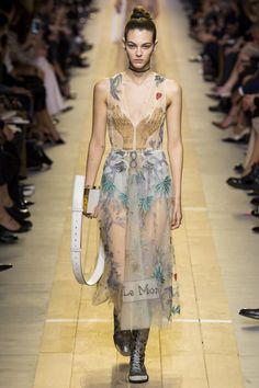 Maria Grazia Chiuri conquers Paris Fashion week with her début collection for the brand - and to onlookers' delight, imparts a new form of grounded, tantalizing feminism to the Dior house for Sprin...