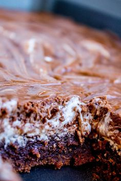 A classic recipe for Mississippi Mud Cake! It's a moist chocolate sheet cake with marshmallow creme and chocolate frosting on top. An incredibly rich and decadent treat!!