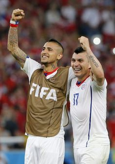 FIFA World Cup 2014 - Chile 2 España 0 (6.18.2014) - El Nuevo Herald Chile's Arturo Vidal (L) and Gary Medel celebrate after winning the FIFA World Cup 2014 group B preliminary round match between Spain and Chile at the Estadio do Maracana in Rio de Janeiro, Brazil, 18 June 2014. Chile won the match 2-0. ABEDIN TAHERKENAREH / EFE