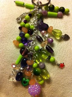 Green, purple, pink, brown beads, silver chain, silver charms key chain  on Etsy, $15.00