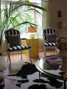 cow hide rug, striped chairs, DIY sunny yellow painted filing cabinet as side table