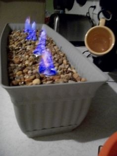 DIY s'mores bar. No instructions I've found are adequate. Building a campfire outside, you can't use just any rocks. Some rocks heat up and explode; some catch fire (coal, e.g.). Lava rocks for grilling would be good. I like the notion of using glass beads as filler--not dangerous and attractive. Any stable terracotta, cast iron, or oven proof container would work.