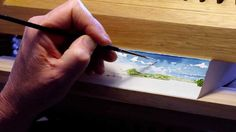 fore-edge painting techniques---painted on the edges of a book with water color. Book must be held still until dry. clamped