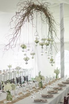 20 Beautiful Reception Lighting Ideas - I'm considering this idea, with red roses instead of the white ones, and little lights (like the xmas), to give a sweet and vintage look to the reception